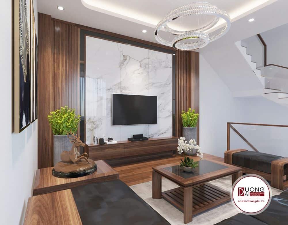 Với sofa gỗ tự nhiên, hệ vách ốp gỗ và vân mây ốp sau tivi chi phí phòng khách vào khoảng 40.000.000đ.