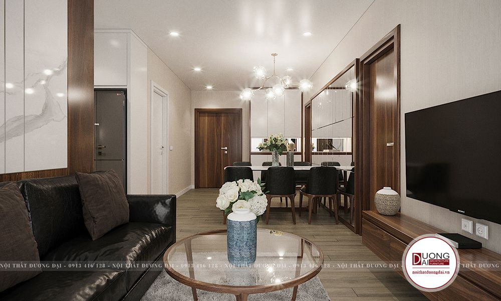 Phòng khách chung cư nhỏ hẹp có bàn ăn đặt giữa để ngăn cách không gian