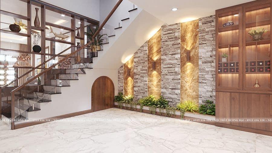 Cầu thang nhà ống đặt giếng trời, phía dưới cầu thang được tận dụng làm tiểu cảnh