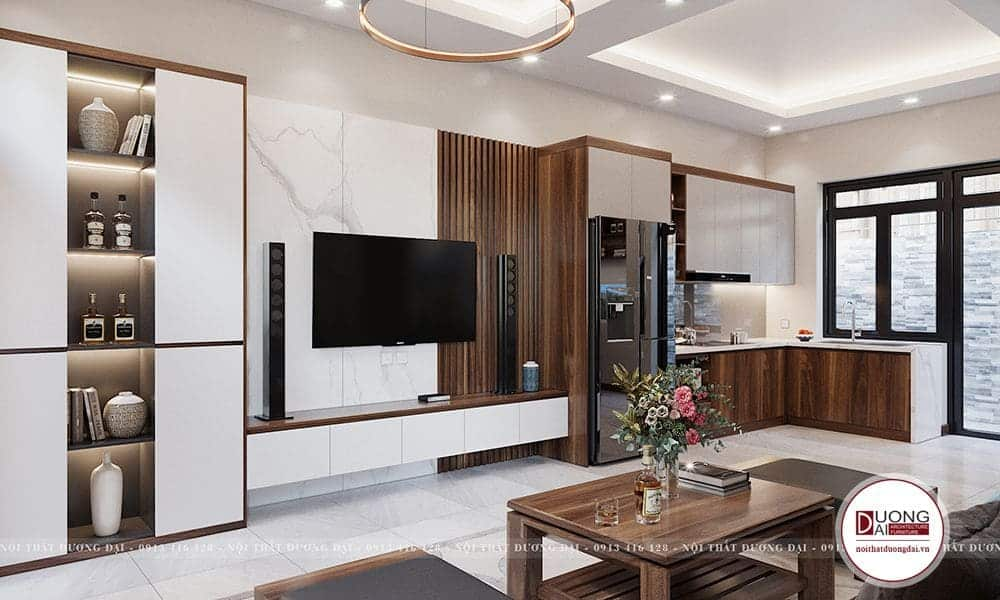 Phòng khách liên thông phòng bếp để tạo được điện tích sinh hoạt tối đa cho gia đình.