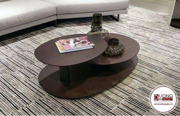 Mãu bàn trà 2 tầng kết hợp từ 3 mặt gỗ và được chà nhám hiện rõ vân gỗ.