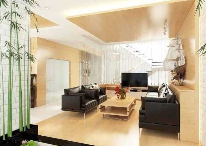 Tông màu gỗ kết hợp sofa chất liệu giả da màu đen theo phong cách hiện đại.
