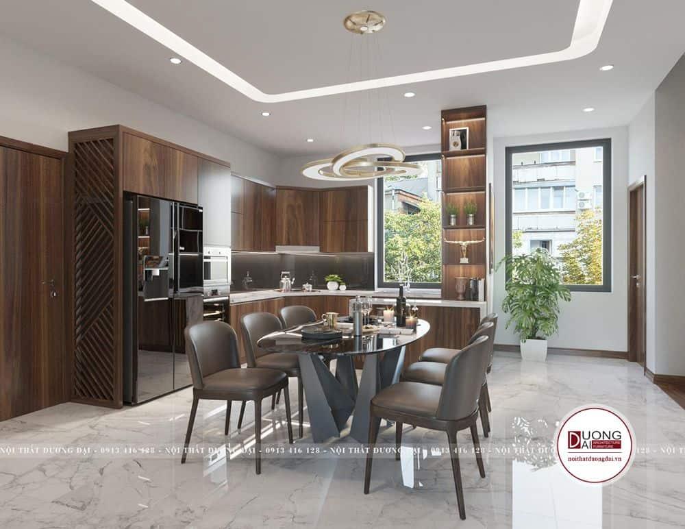 Phòng bếp thiết kế theo phong cách hiện đại, với một số kệ và bàn soạn.