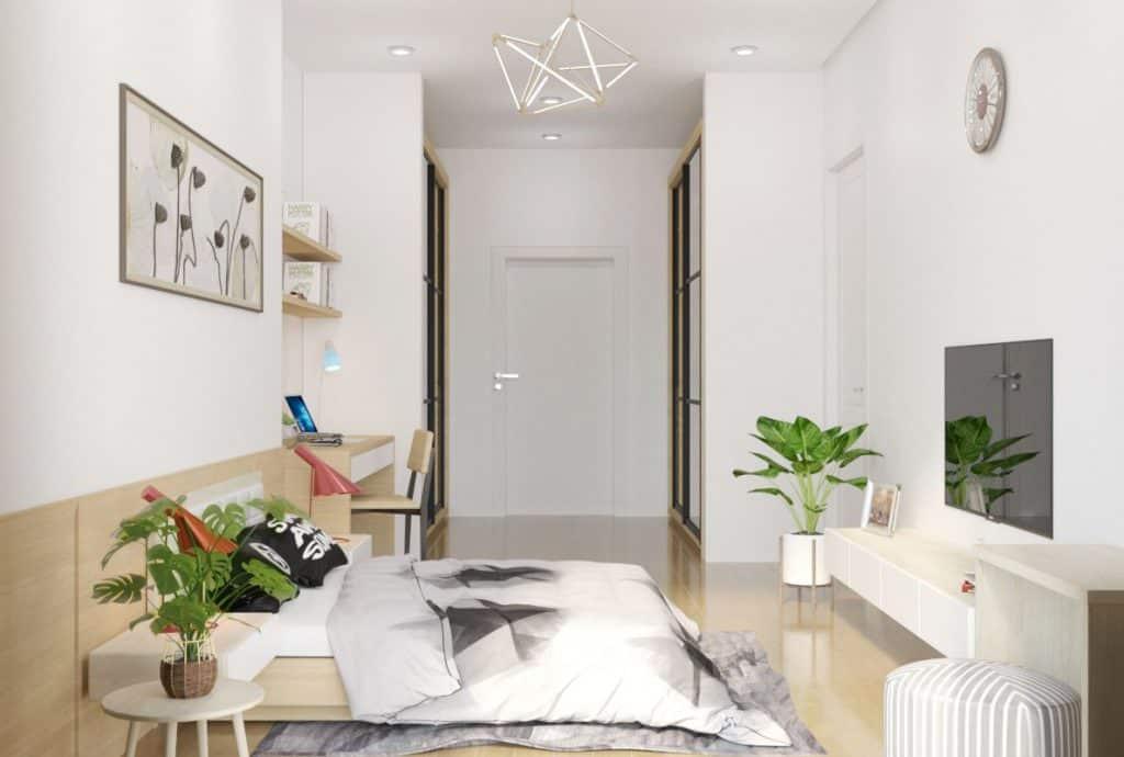 Phòng ngủ master được ưu tiên về vị trí và diện tích. KTS sử dụng bộ đèn bàn màu hồng cùng cây xanh làm điểm nhấn cho không gian.