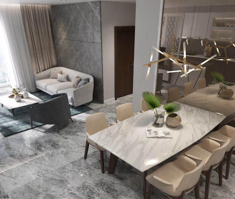 Mặt bàn làm bằng đá cẩm thạch tạo nét tương đồng với sàn và cấu trúc nhà.