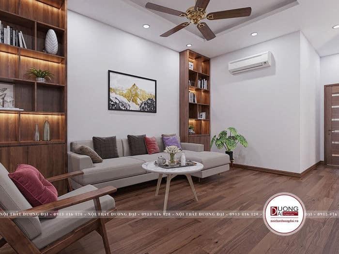 Không gian ấm áp với giá sách lớn và sofa mềm mại cho gia đình đọc sách