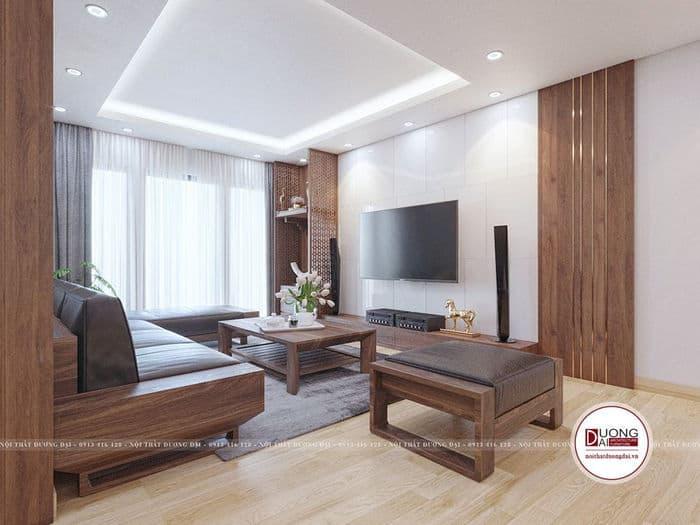 Phòng khách có kệ tivi và sofa màu nâu trầm tinh tế