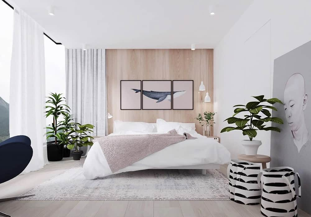 Phòng ngủ được trang trí đơn giản bằng cây xanh cùng cửa kính lớn