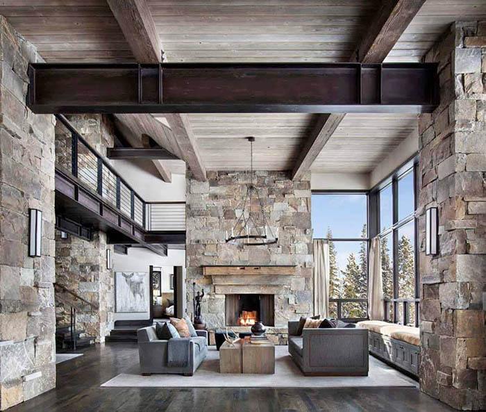Phòng khách theo phong cách Rustic cổ điển với tường đá bao quanh