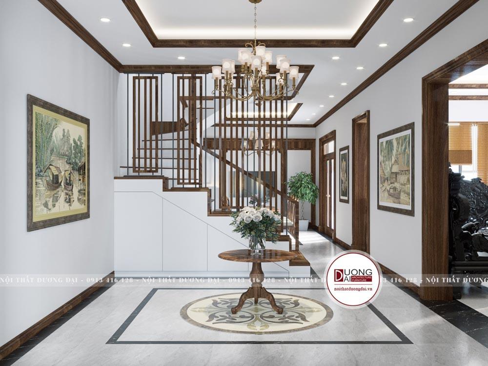Sảnh cầu thang được thiết kế sang trọng với kệ trang trí tròn đặt chính giữa