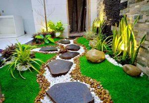 Với phần nền thì bạn có thể trang trí bằng những dải cỏ xanh nhân tạo.