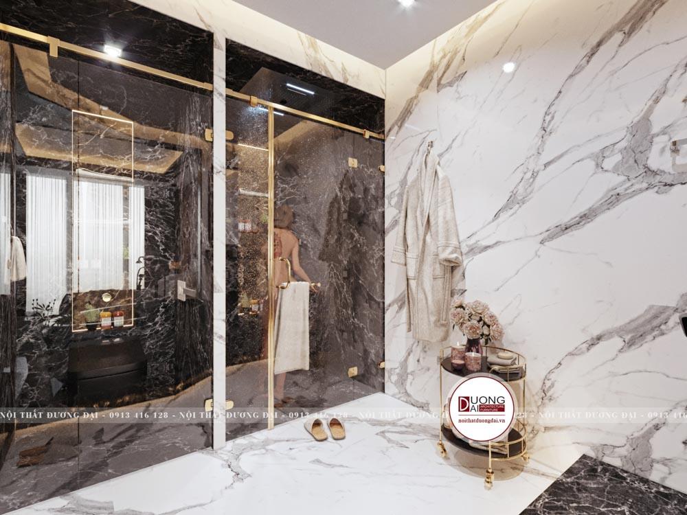 Một nhà vệ sinh nhỏ được đặt với chất liệu đá cao cấp